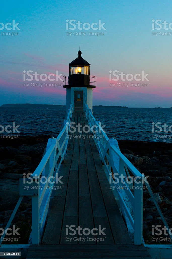 Marshall Point Lighthouse at Sunset stock photo