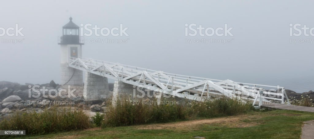 Marshall Point Lighthouse in Maine and fog stock photo