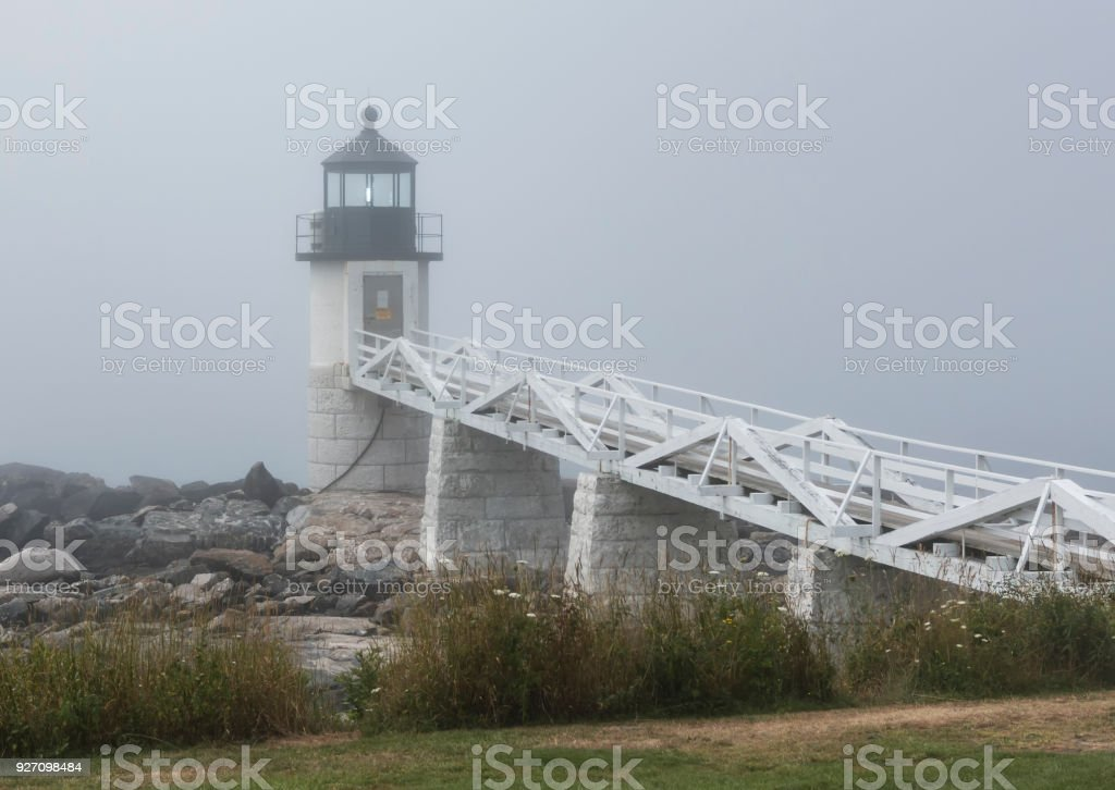 Marshall Point Lighthouse in the fog in Maine stock photo