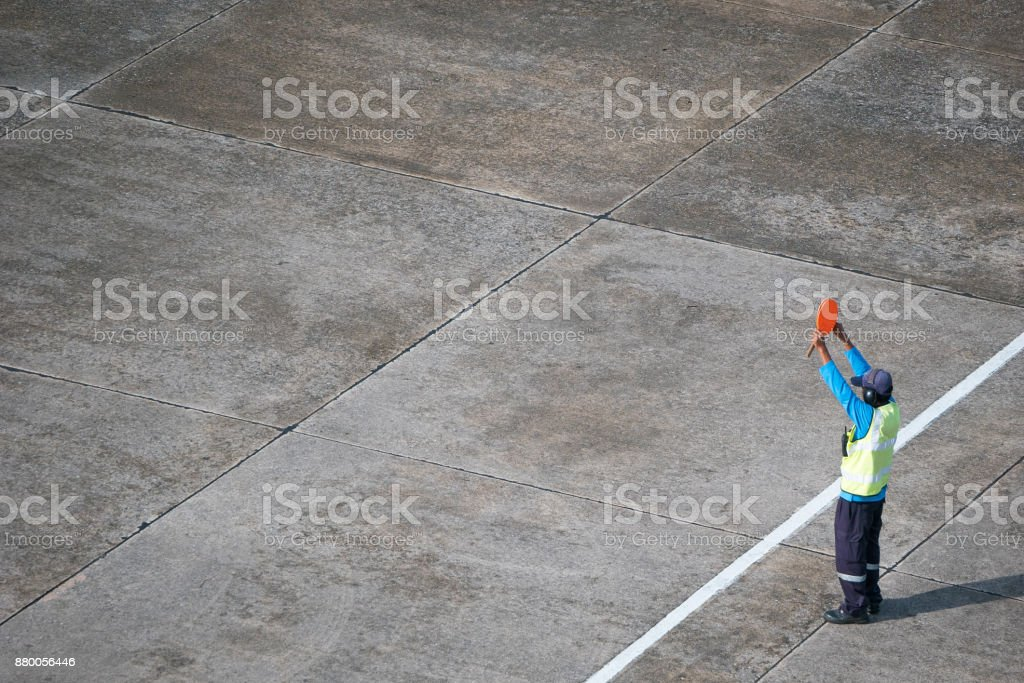 Marshaller signalling to stop the aircraft stock photo