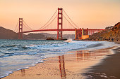 Stock photograph of Marshall's Beach and the landmark Golden Gate Bridge in San Francisco California USA during sunset gold hour.