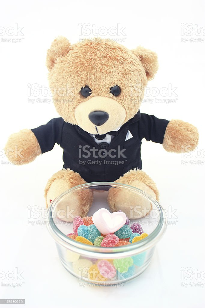 marshmallow and candies with bear doll in tuxedo isolated stock photo