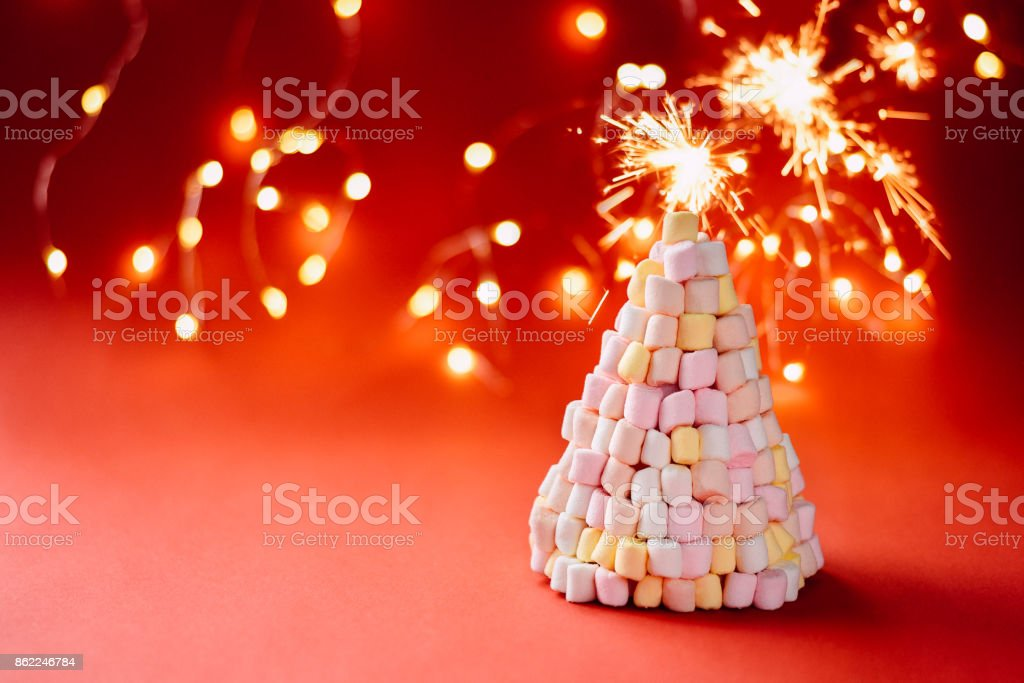 Marshmallow christmas tree on red background stock photo