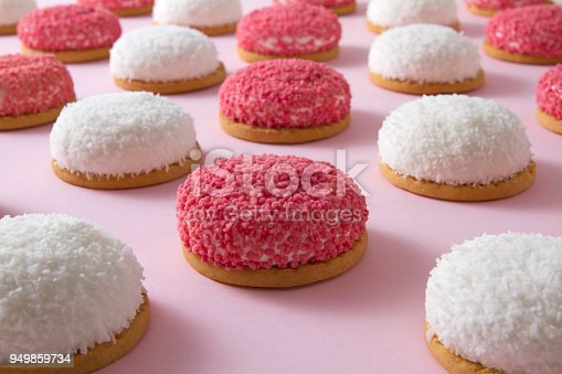 Pattern with sweet strawberry and coconut flavored marshmallow cookies on pink background. Minimal food background concept