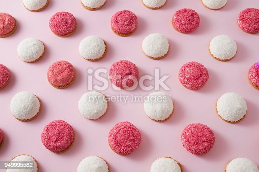 Pattern with sweet strawberry and coconut flavored marshmallow cookies on pink background