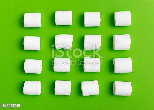 Pattern sweet marshmallow, candy on green background, top view flat lay. Isolated minimal concept above decoration, view white marshmallow, food background