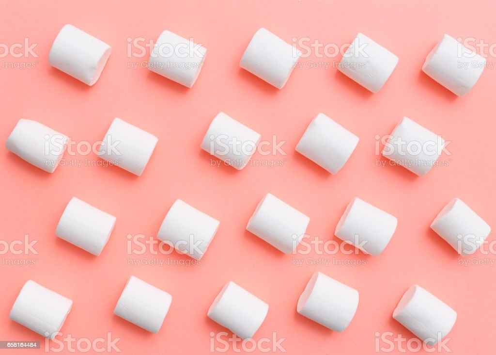 marshmallow pattern, top view flat lay on colorful background stock photo