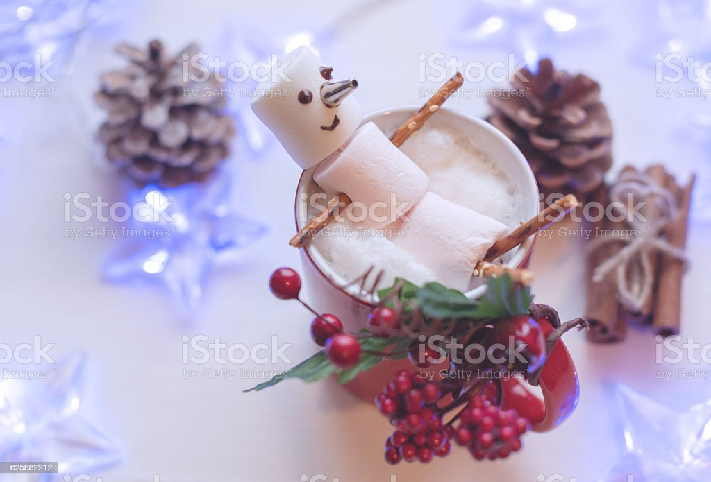 Marshmallow snowman in red cup of hot chocolate stock photo