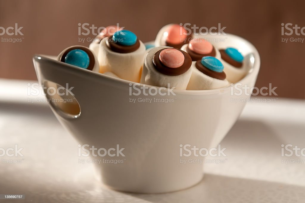Marshmallows Decorated with Chocolate and Candies in a Bowl royalty-free stock photo