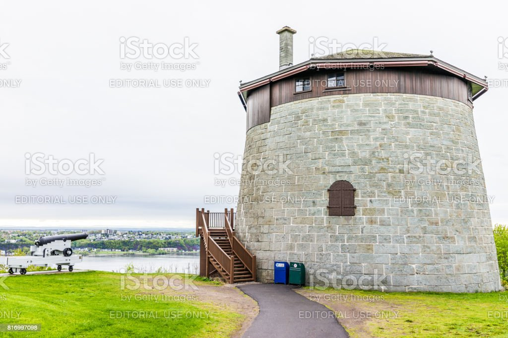 Martello tower watchtower in plaines d'Abraham with sign and cannon overlooking the Saint Lawrence river stock photo