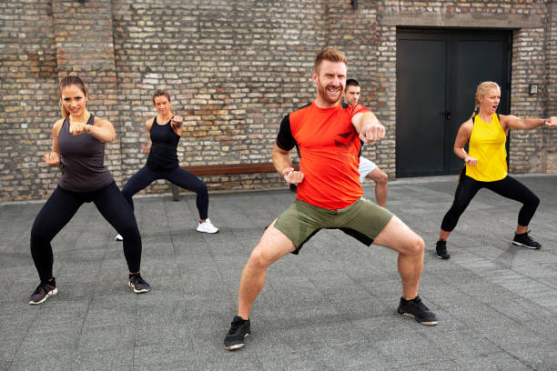 Martial art coach training his group of people stock photo