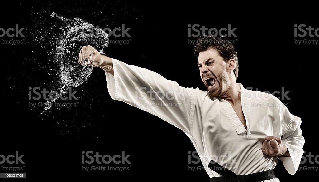 Martial art water splash punch royalty-free stock photo
