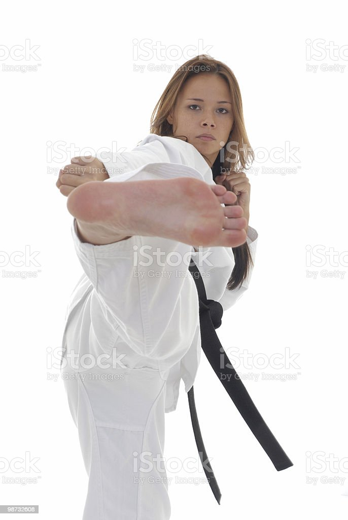 Martial artist kicking on target royalty-free stock photo