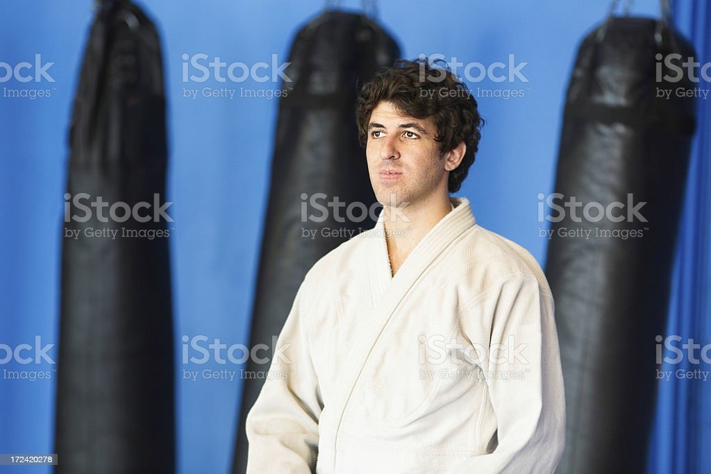 Martial Arts Athlete Pensive in Dojo Gym royalty-free stock photo