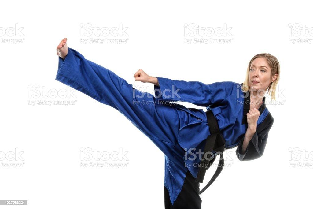 Martial Arts Kick Execution stock photo