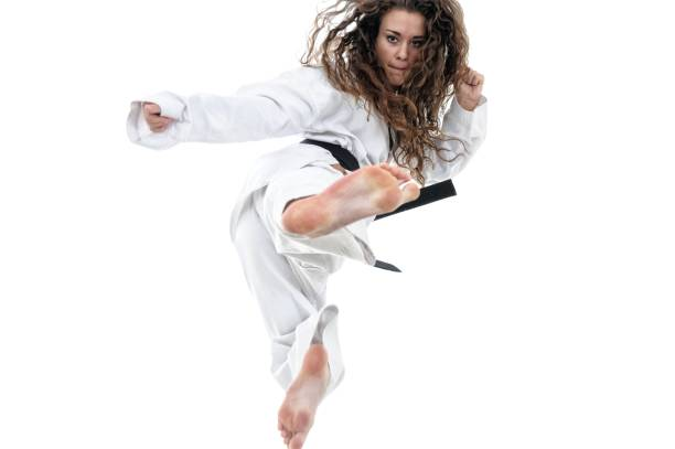 martial arts leap and kick - martial arts gerville stock photos and pictures