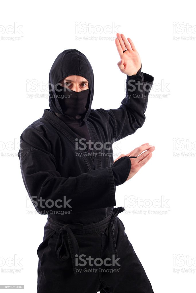 Martial Arts Ninja in Black Threatening Traditional Karate Chop stock photo
