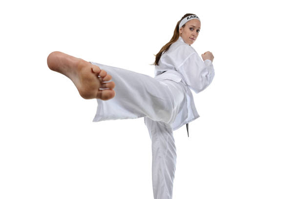 martial arts side kick and exercise - martial arts gerville stock photos and pictures
