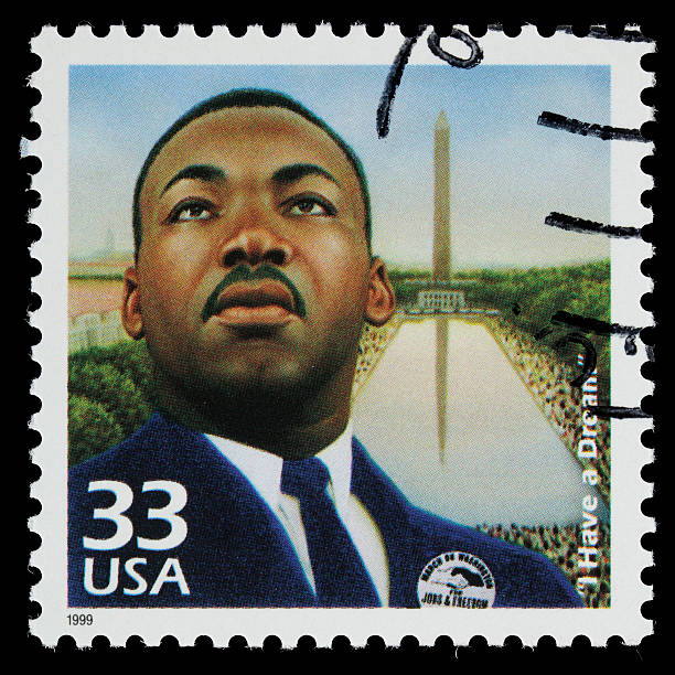 "USA Martin Luther King Jr postage stamp Sacramento, California, USA - March 19, 2011: A 1999 USA postage stamp with an image of Martin Luther King, Jr (1929-1968). King is depicted wearing a badge that reads: MARCH ON WASHINGTON FOR JOBS & FREEDOM, and in the background is the Washington Memorial and a large crowd of people. The stamp commemorates the August 28, 1963 demonstration in Washington, D.C. in which King delivered his historic ""I Have a Dream"" speech. mlk stock pictures, royalty-free photos & images"