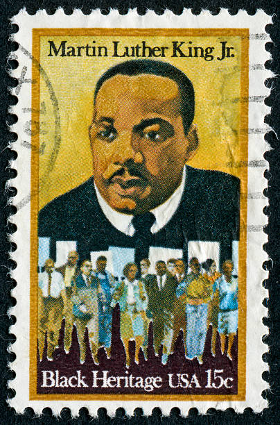 """Martin Luther King Jr. Stamp """"Richmond, Virginia, USA - March 15th, 2012:  Cancelled Stamp From The United States Featuring The Black Civil Rights Leader, Martin Luther King Jr."""" martin luther king jr photos stock pictures, royalty-free photos & images"""