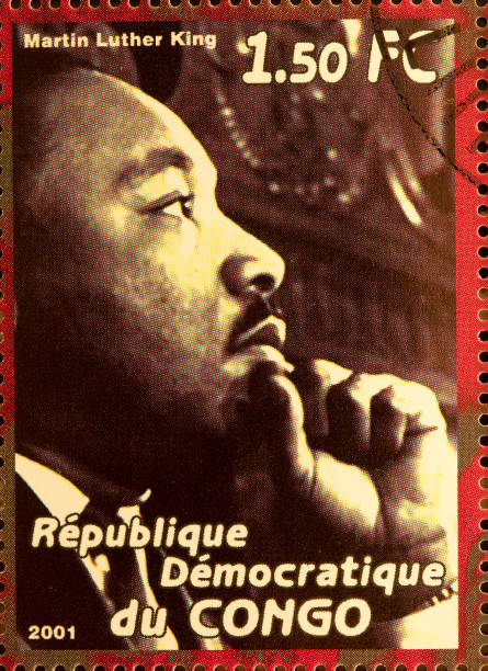 "Martin Luther King ""Newcastle, United Kingdom - September 18, 2012: Martin Luther King featured on a stamp from The Republique du Congo in 2001"" martin luther king jr stock pictures, royalty-free photos & images"