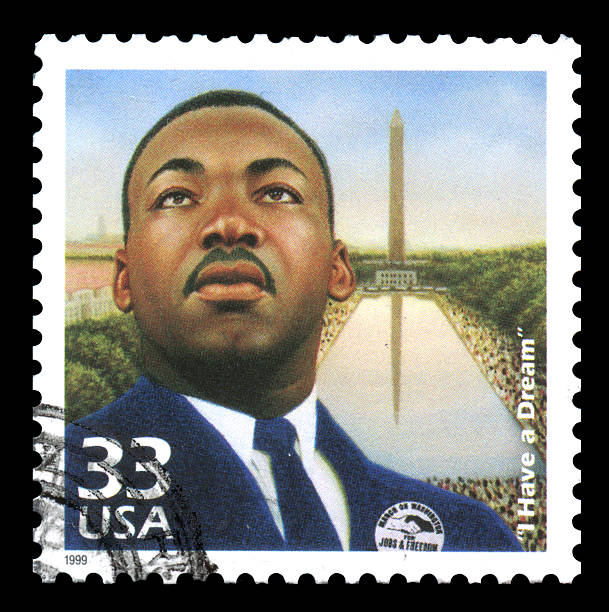 Martin Luther King USA Postage Stamp London, UK – January 15, 2012: USA postage stamp of 1999 showing an image of Martin Luther King with his famous quotation of \'I have a dream\' mlk stock pictures, royalty-free photos & images
