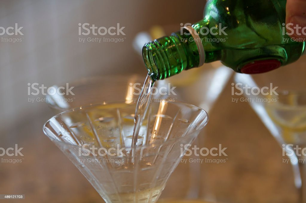 Martini being poured stock photo