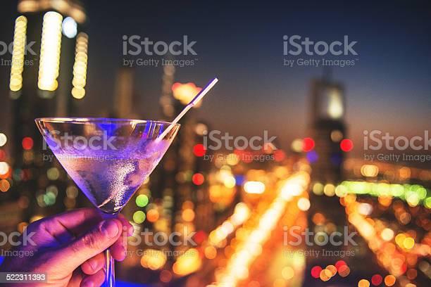 Martini drink with city lights of dubai downtown picture id522311393?b=1&k=6&m=522311393&s=612x612&h=z2xgfptu5okjsvcmt5hsmtgeaex9yold31kklg7gutq=