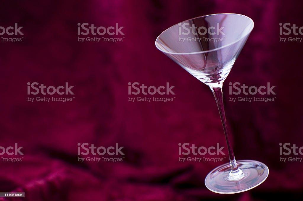 Martini Glass Floating on Red Velvet Background royalty-free stock photo