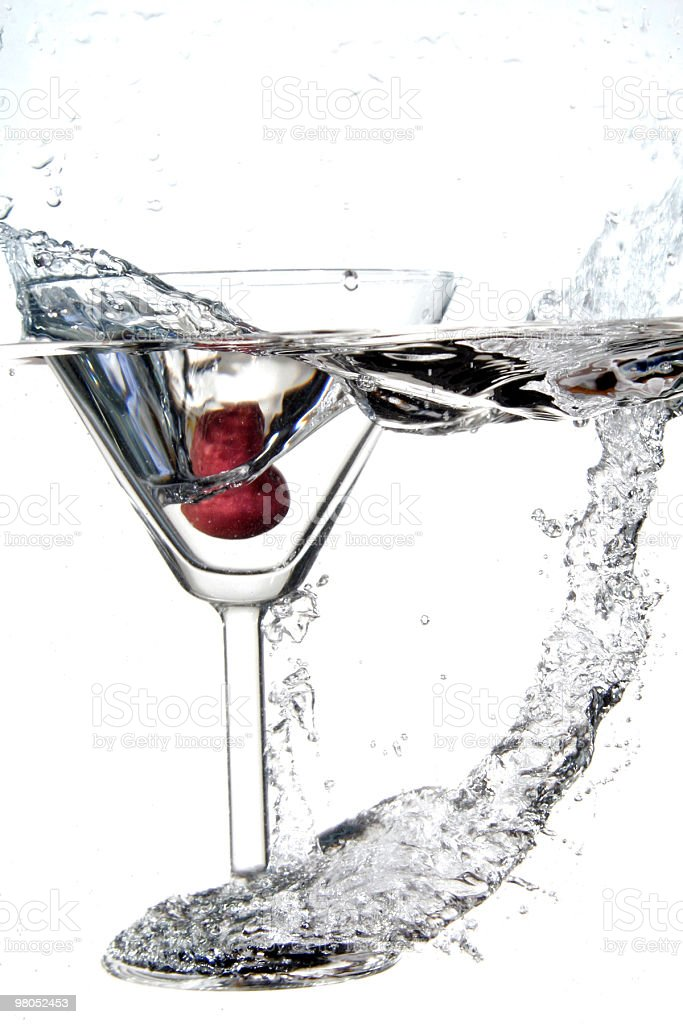 martini glass spashng into water royalty-free stock photo