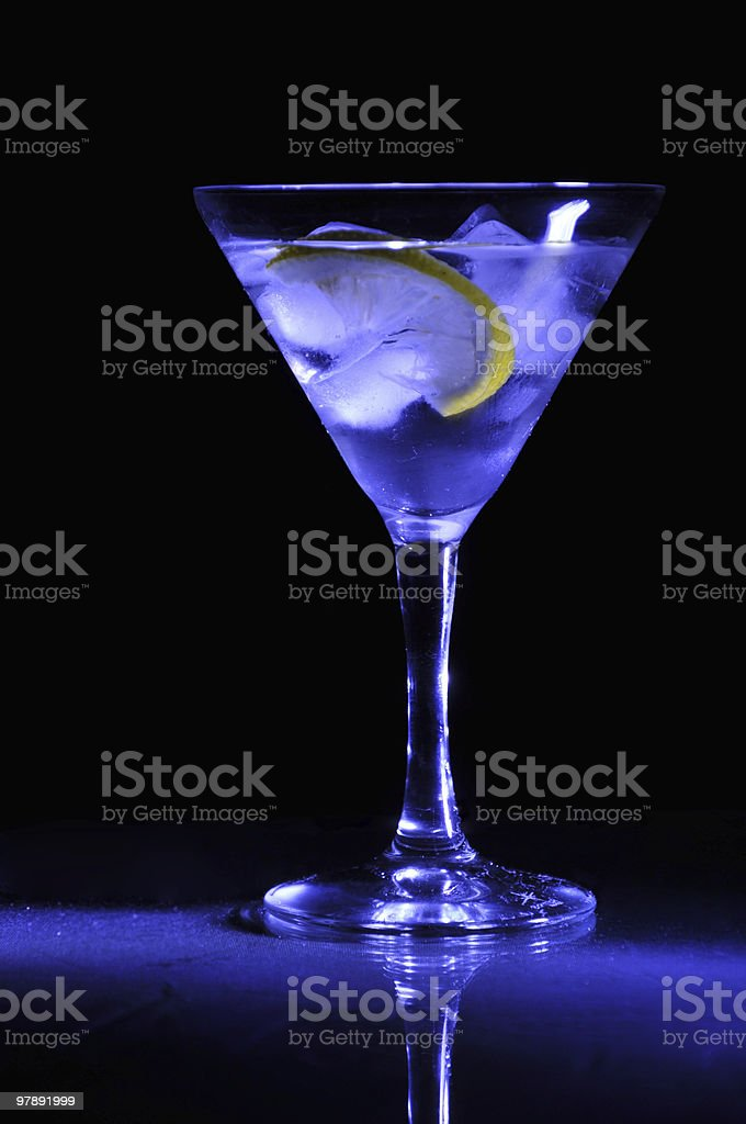 Martini glass standing on the table royalty-free stock photo