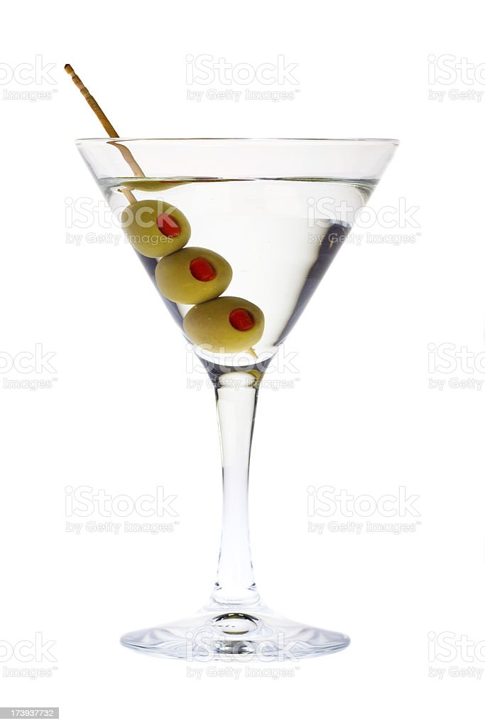 martini glass with green olive and toothpick isolated on white stock photo