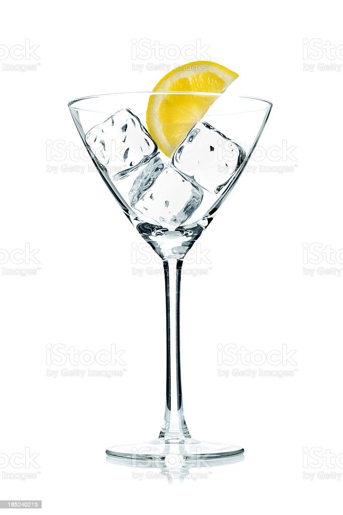 Martini glass with lemon and ice royalty-free stock photo