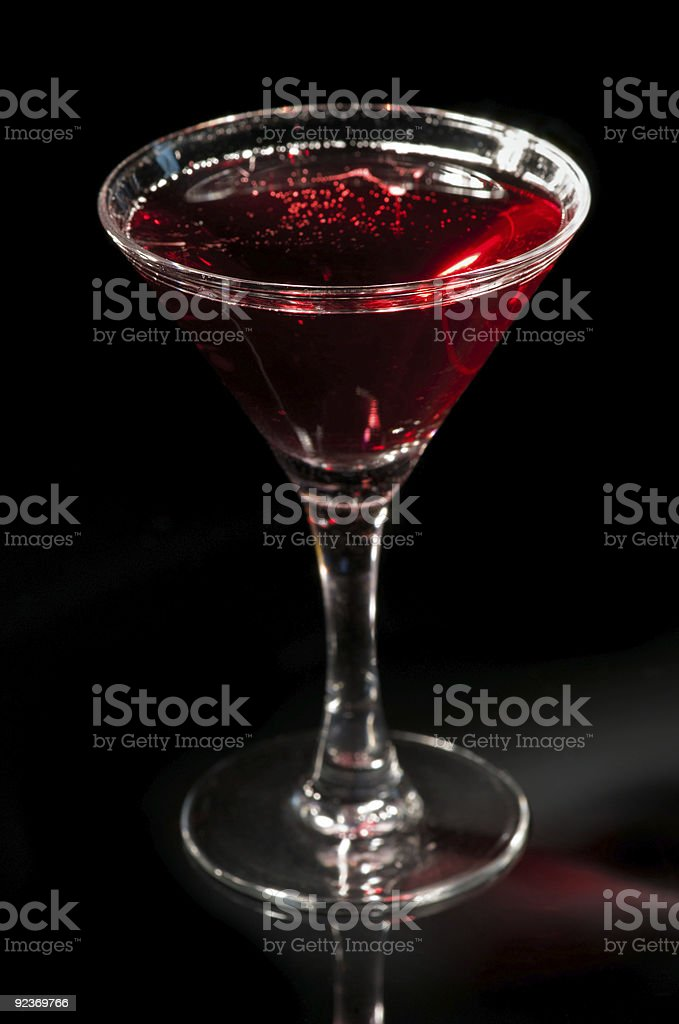 Martini glass with red cocktail royalty-free stock photo
