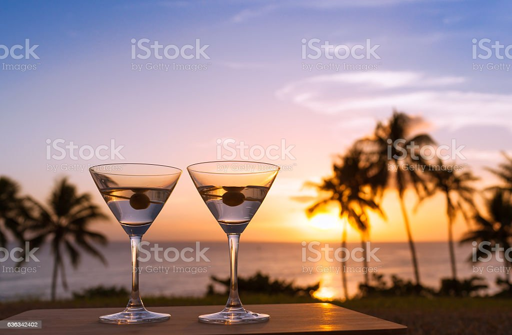 Martini glasses against sunset stock photo