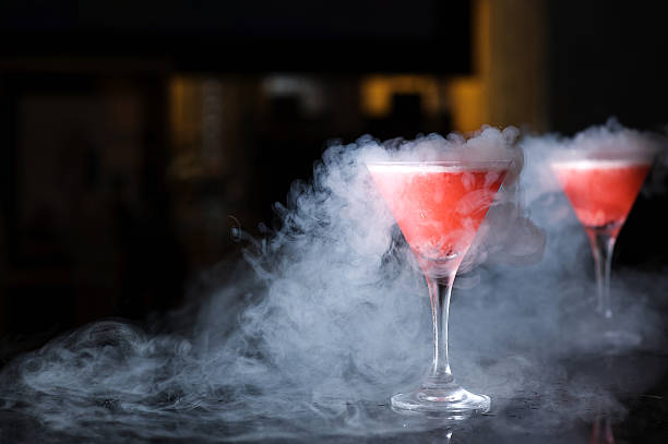 Martini Glasses Two glasses with smoke from liquid nitrogen nitrogen stock pictures, royalty-free photos & images