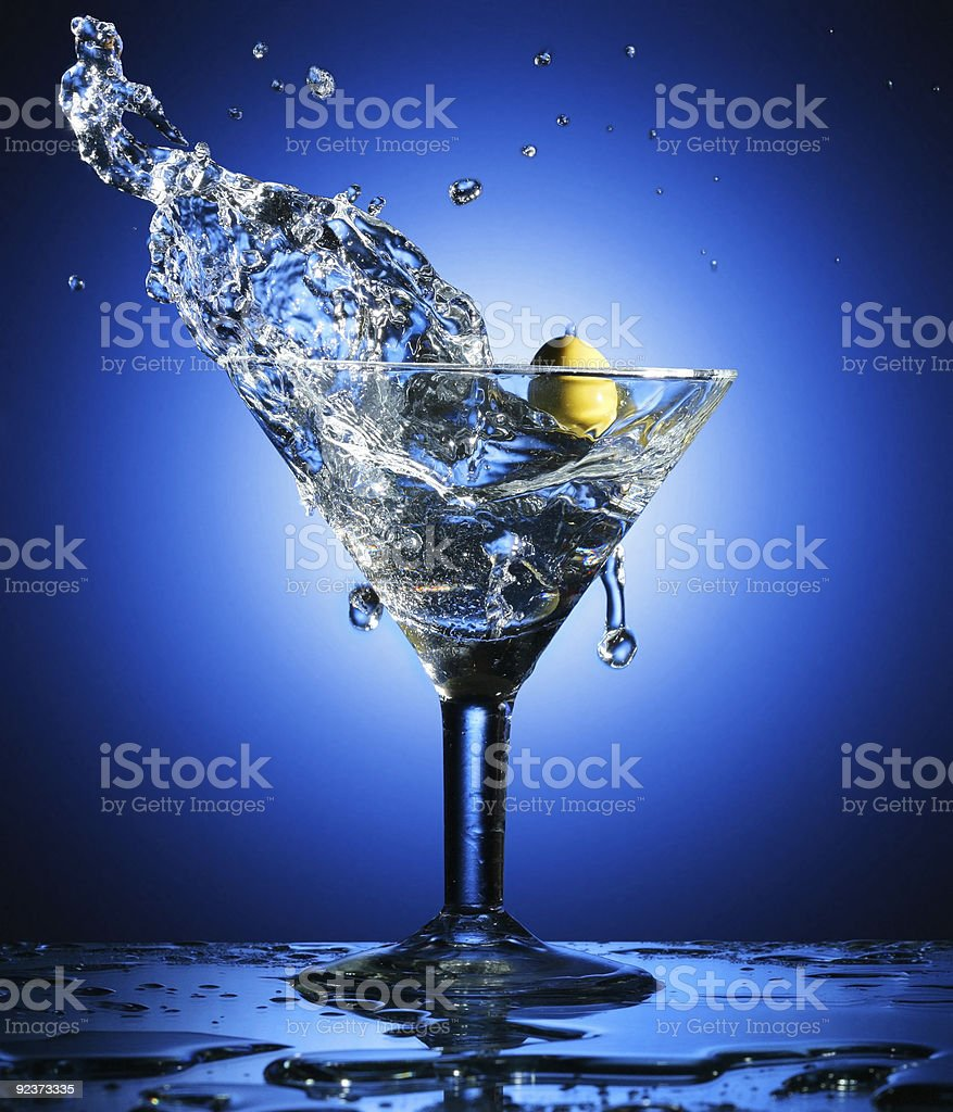 Martini; objects on blue background royalty-free stock photo