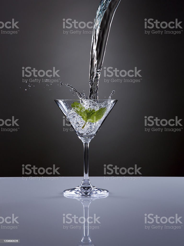 Martini splash in a glass with ice. royalty-free stock photo