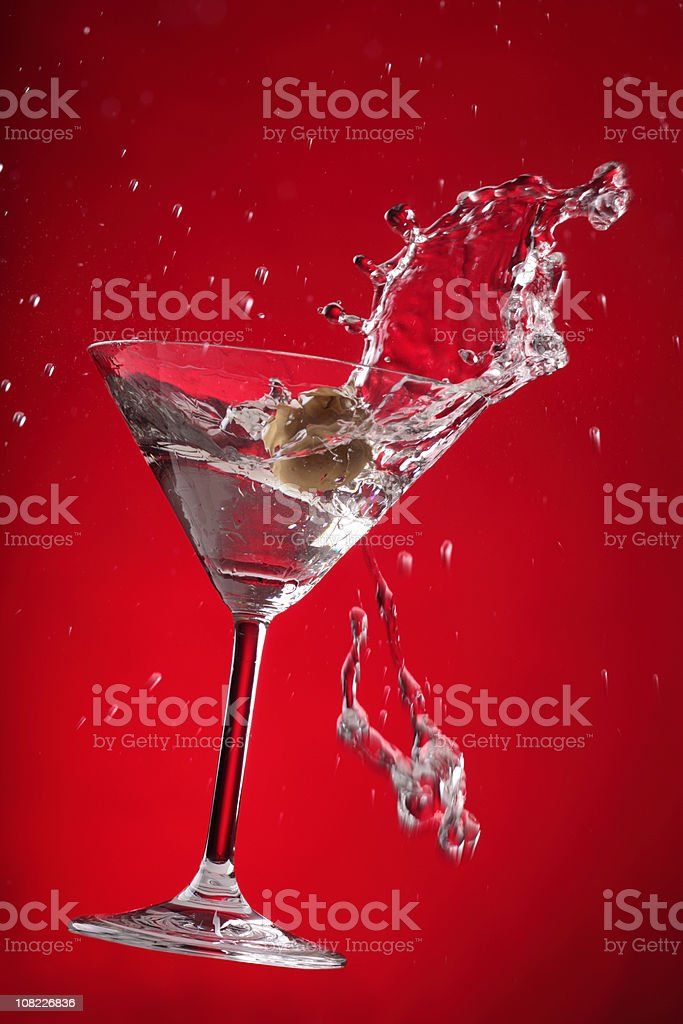 Martini Splashing on Red Background royalty-free stock photo