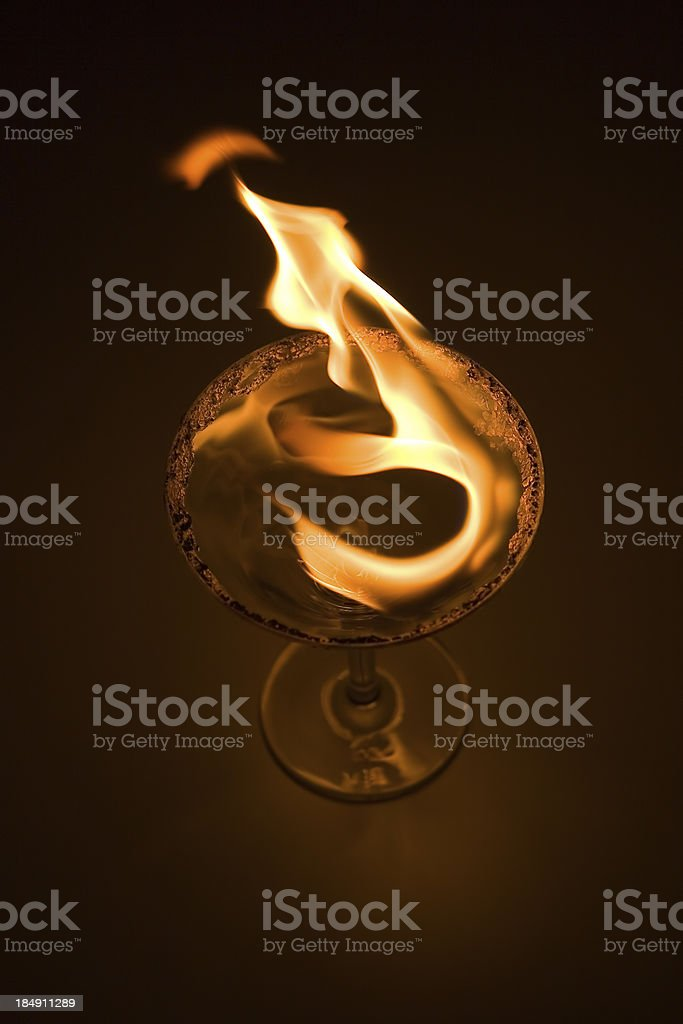 martini with fire on top royalty-free stock photo