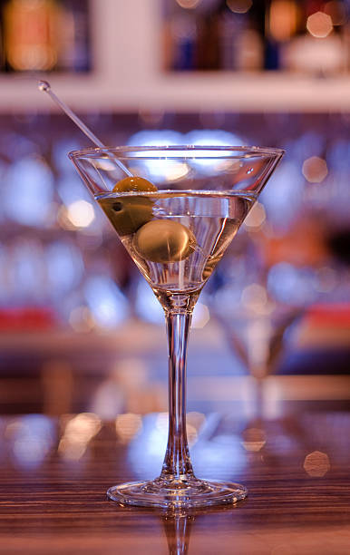 Martini with olives on a bar stock photo