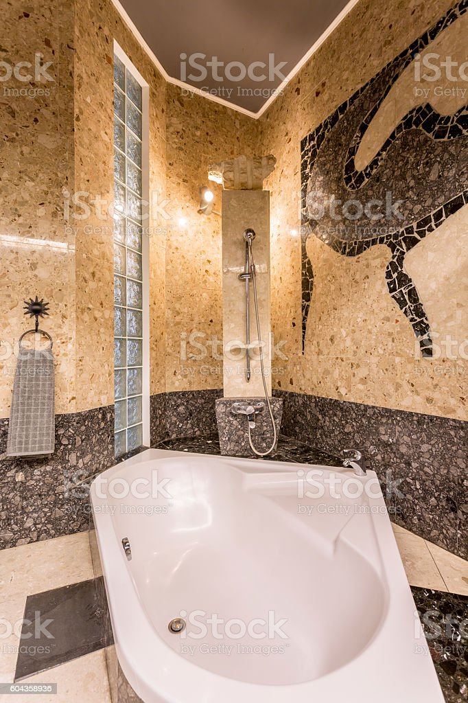 Marvellous stone bathroom resembling baths of Far East stock photo