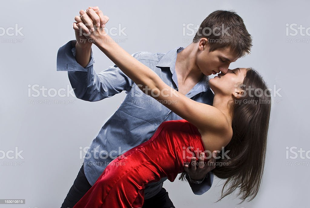 Marvelous girl enjoying in dance with her boyfriend stock photo