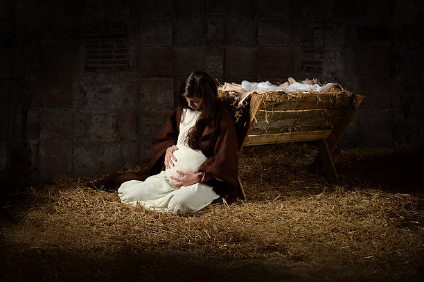 Mary and the Manger on Christmas Eve stock photo
