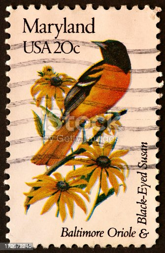 postage stamp honoring the state of Maryland and it's state bird and flower.