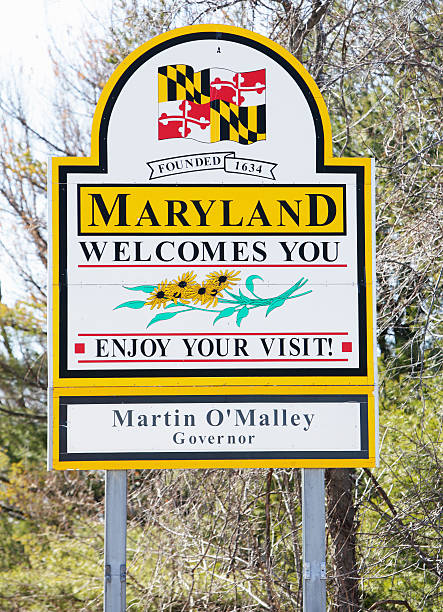 "Maryland State Line Welcome Sign Emmitsburg, Maryland, USA - March 7, 2011: ""Maryland Welcomes You"" billboard sign on Route 15 southbound just north of Emmitsburg, MD at the Maryland-Pennsylvania state border line. maryland us state stock pictures, royalty-free photos & images"