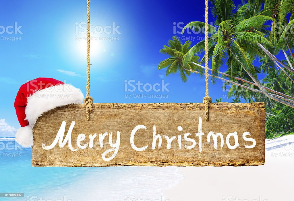 X'Mas Wooden Sign at the Beach royalty-free stock photo