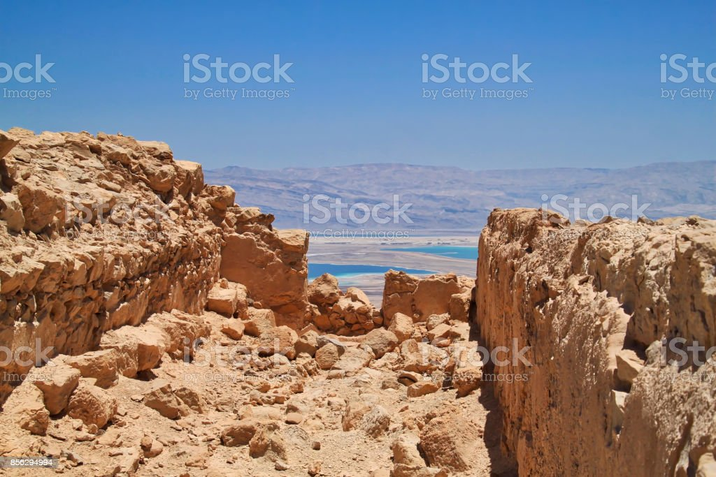 Masada archaeological ruins, with a view of the Dead Sea and Jordanian mountains in background stock photo
