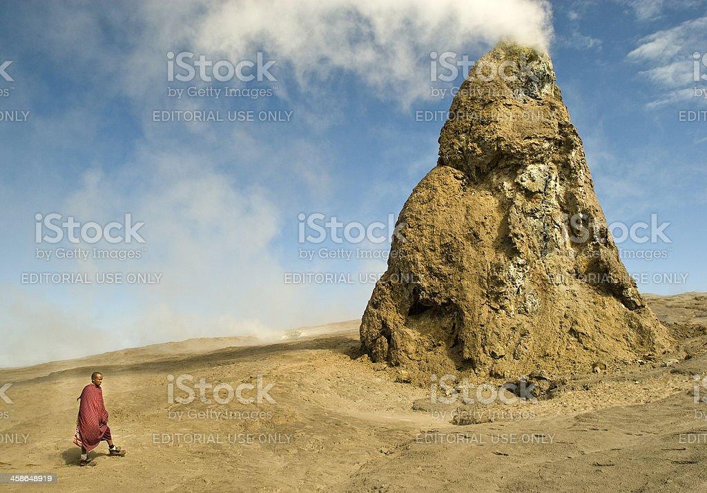 Masai man in front of Hornitos at Ol Doinyo Lengai stock photo