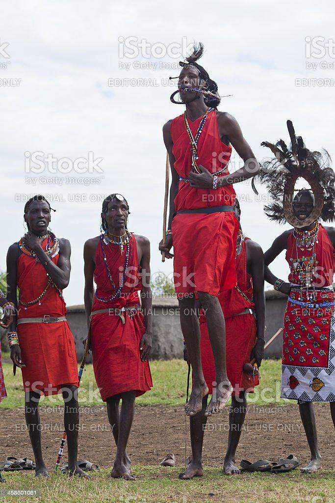 Masai Man Jumping High in Display of Strength stock photo